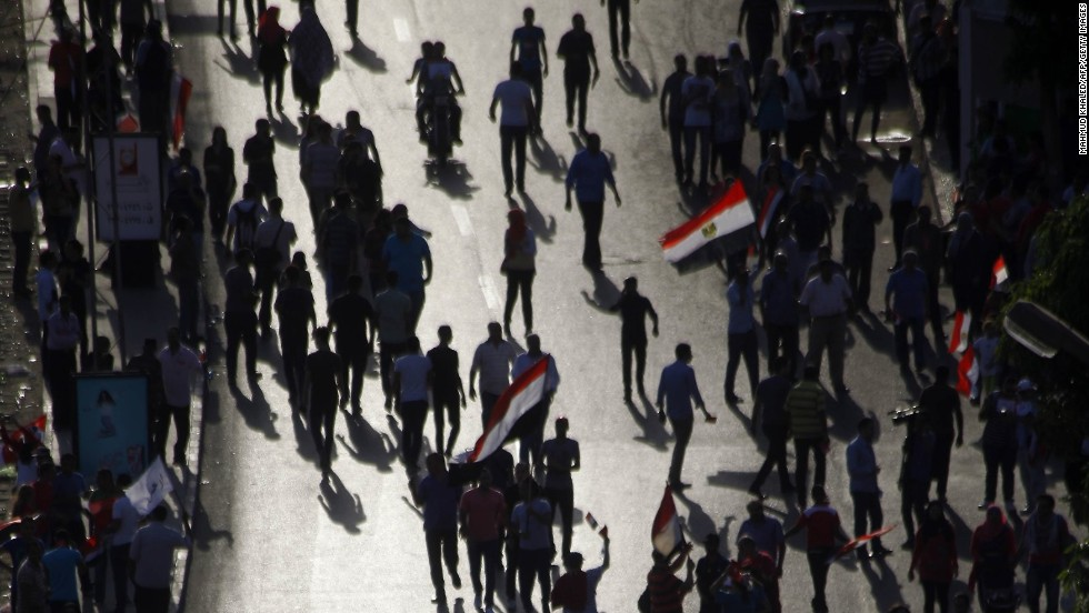 JULY 1 - CAIRO, EGYPT: Opponents of Egypt's Islamist President Mohamed Morsy <a href='http://cnn.com/2013/06/30/world/africa/egypt-protests/index.html'>gather for a protest outside the presidential palace in Cairo</a>, calling for Morsy to step down. Egyptians who helped overthrow a 29-year dictatorship in a widely-hailed revolution have now given the country's first democratically elected president <a href='http://cnn.com/2013/07/01/world/meast/egypt-protests/index.html'>one day to resign</a>.