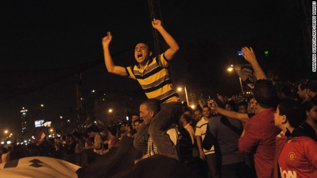 Hundreds of thousands of Morsy opponents chant outside the presidential palace on June 30.