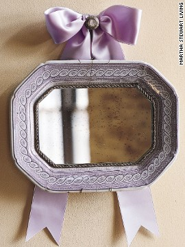 Just because an antique platter or plate is scratched, cracked, or broken, doesn't mean its useful life has to end. Its patterned border can be used as the decorative frame for a mirror.