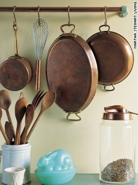 Their sleek glass and porcelain rods long gone, enameled, ceramic, and metal towel-bar supports often turn up at flea markets. Attractive -- but what can you do with them? Show off the hardware in another room.