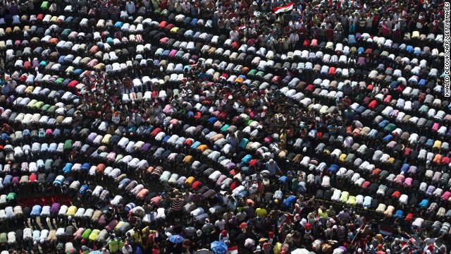 Thousands of opponents of Egyptian President Morsy pray during a protest calling for his ouster on Sunday, June 30. On the first anniversary of his inauguration, Morsy's Islamist supporters vow to defend his legitimacy to the end.