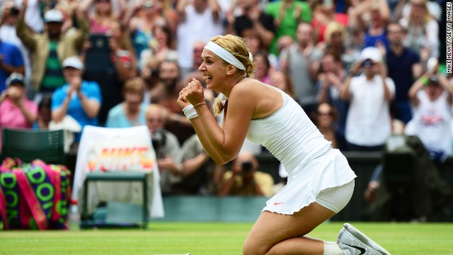 Germany's Sabine Lisicki celebrates after defeating World No.1 Serena Williams on Centre Court Monday. Lisicki prevailed 6-2 1-6 6-4 following an enthralling tussle.
