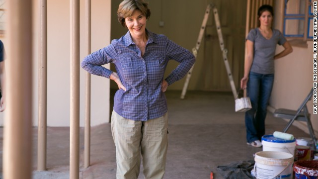 Laura Bush pauses at the Mosi Oa Tuny Clinic.