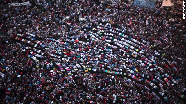 Protesters pray during a demonstration against Morsy in Cairo's Tahrir Square on Monday, July 1. Pro- and anti-government demonstrations have spread around the country surrounding the one-year mark of Morsy coming into office on Sunday, June 30.