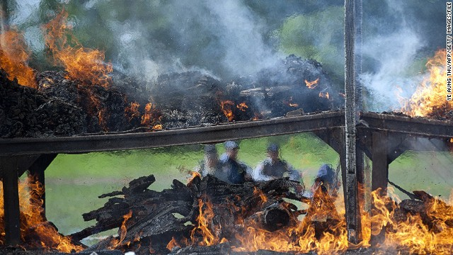 Authorities in Myanmar burn drugs seized across the country for a ceremony against drug abuse and trafficking last month.