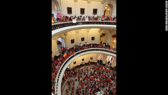 Demonstrators on both sides gather in the Capitol on July 1.