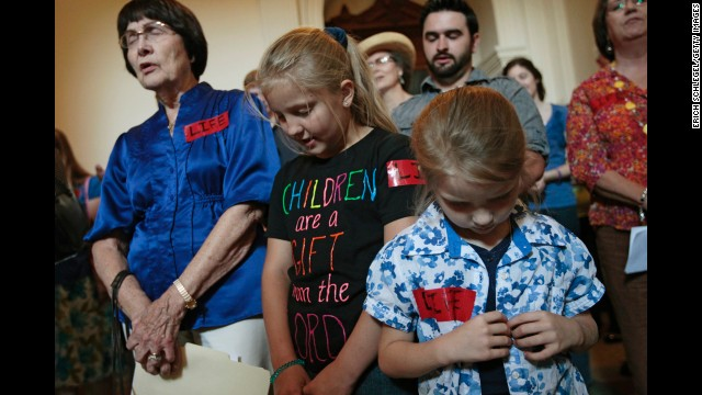 Anti-abortion activists pray at the Capitol on July 1.