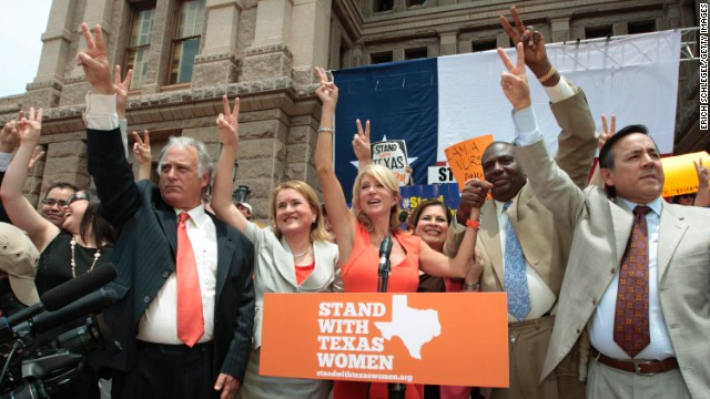 Davis, center, is surrounded by Texas representatives and senators July 1 after leading a rally in support of women's rights to reproductive decisions.