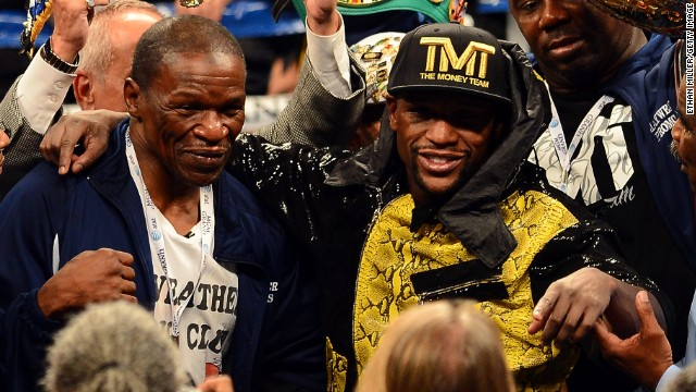 Floyd Mayweather Jr. and his father -- and trainer -- Floyd Sr. celebrate the victory <a href=