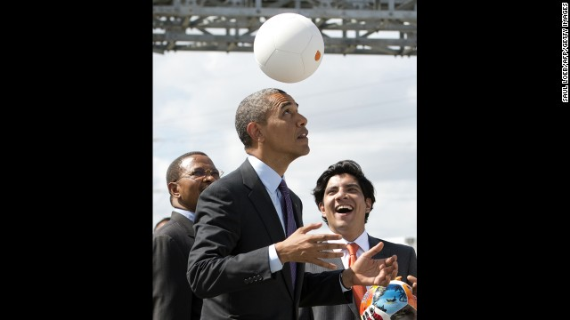 "Tanzania's president, left, watches as Obama plays with the energy-generating soccer ball at the Symbion Power Plant on July 2. ""I don't want to get too technical, but I thought it was pretty cool,"" Obama said of the ball that harnesses kinetic energy to provide power."