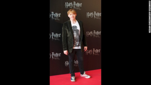 "Rupert Grint walks the red carpet in red, white and blue sneakers at the Madrid premiere of ""Harry Potter and the Deathly Hallows: Part 2"" in June 2011."