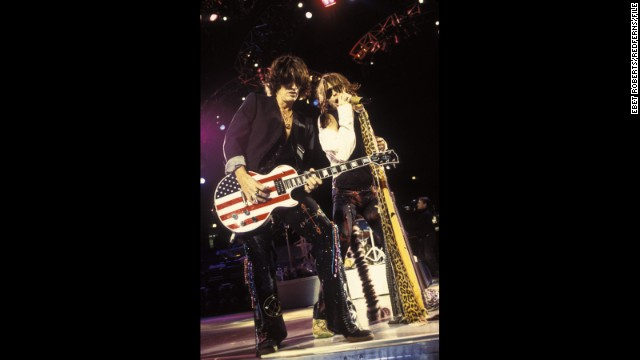 Aerosmith's Joe Perry rocks out on a stars and stripes Gibson Les Paul guitar with Steven Tyler at Madison Square Garden in November 2001.