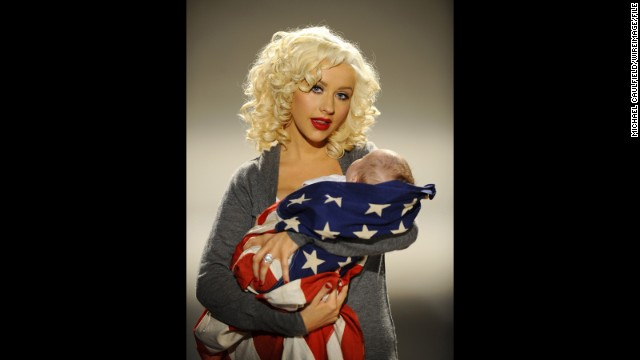 "Singer Christina Aguilera wraps her son, Max, in the flag to help ""Rock the Vote"" in April 2008."