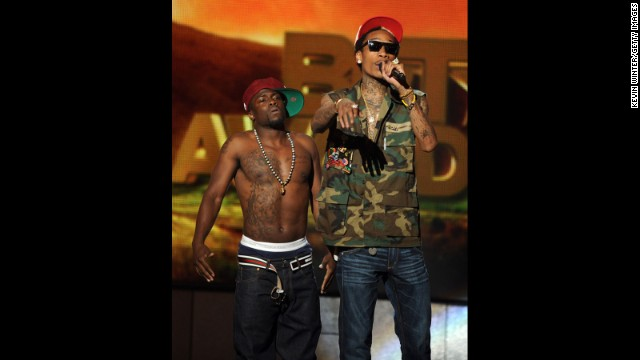 "Kevin ""Chocolate Droppa"" Hart and rapper Wiz Khalifa speak onstage during the BET Awards '11 held at the Shrine Auditorium on June 26, 2011, in Los Angeles."