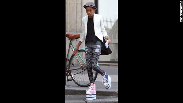 Willow Smith keeps her balance atop a serious pair of Americana-inspired platforms while in France in May 2012.