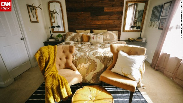 <a href='http://ireport.cnn.com/docs/DOC-996649'>Liz Marie,</a> an interior design student and blogger from North Carolina, teamed up with her husband to create a headboard that would be the focal point of their master bedroom. They built their<a href='http://www.lizmarieblog.com/2012/12/master-bedroom-reveal/' target='_blank'> floor-to-ceiling headboard</a> from rustic boards that make a dramatic contrast against their cream bedroom walls.