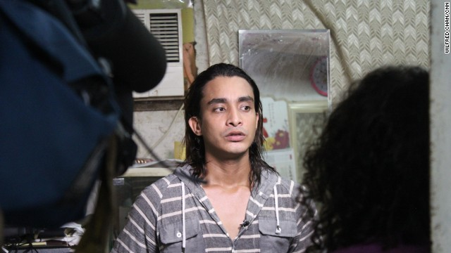 "Arif, a 26-year old refugee from Bangladesh, sits for an interview with CNN reporters in the slum of Ping Che on June 25, 2013. Arif, formerly a pharmacology student and business owner, fled his native country in 2009 when terrorists threatened to kill him. ""I lost everything,"" he says."