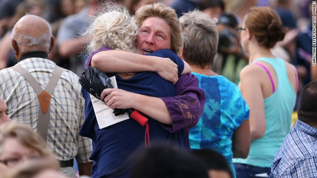 Family members of victims hug as they arrive at a vigil at Prescott High School on July 2. The elite team members' deaths on Sunday, June 30, marked the deadliest day for U.S. firefighters since the 9/11 attacks.
