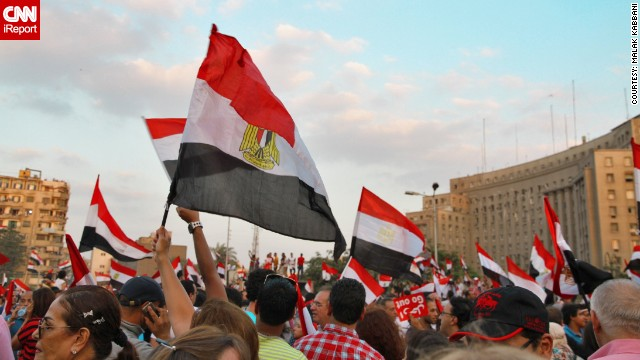 "iReporter <a href='http://ireport.cnn.com/people/mgkab'>Malak Kabbani</a> sent in images from protests held July 2. She told CNN: ""The energy in Tahrir is very positive, the protests have been very peaceful all over Cairo and surrounding Egyptian states so far."""