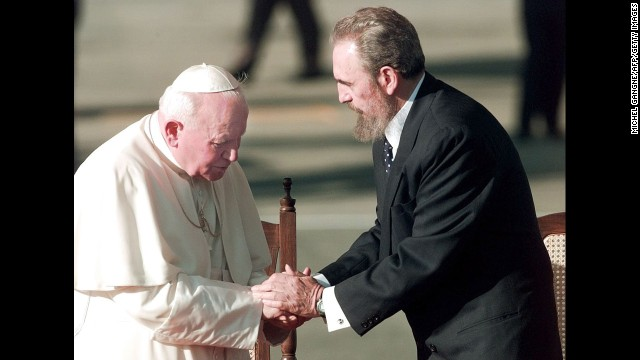 Cuban leader Fidel Castro greets the pope in Cuba in January 1998. John Paul II was the first pontiff to visit the Caribbean island nation.