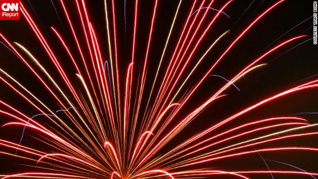 "Fitness instructor Tracy Bond loves the ""buzz"" of Independence Day -- and the spectacular celebrations. ""A day off of work for many, picnics, maybe some time at the pool or lake -- and of course, at the end of the day, sonic booms followed by <a href='http://ireport.cnn.com/docs/DOC-996491'>shimmering, multi-colored fire</a> bringing oohs and aahs from young and old. What's not to like?"" she says."
