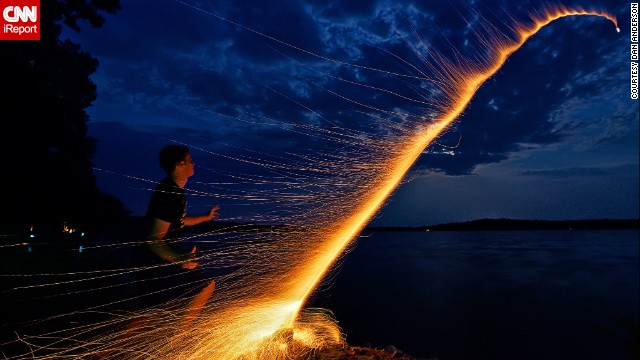 "Dan Anderson managed to capture the moment his nephew <a href='http://ireport.cnn.com/docs/DOC-996552'>launched a bottle rocket</a> across Minnesota's Lake Koronis, during Fourth of July 2012. They had carefully prepared everything to take the perfect photo, counting the seconds it took from lighting the fuse to the explosion of the firework and arranging the camera on a tripod. ""We did it in one take and then ran away because the mosquitoes were eating us alive,"" Anderson says."
