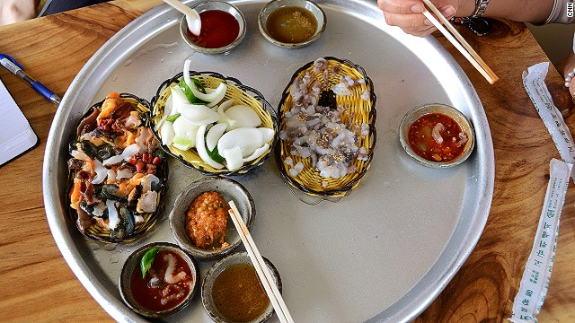 Conch and live octopus are served with their respective sauces -- gochujang (red pepper paste) and salty sesame oil.