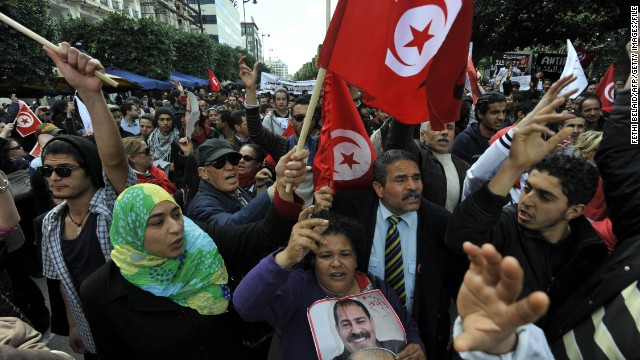 People demonstrate in Tunis in March to mark the 40th day of mourning after the death of Chokri Belaid, a vocal critic of Tunisia's Islamist-led government. <a href='http://www.cnn.com/2013/02/06/world/meast/tunisia-opposition-leader-killed'>Belaid, 48, was gunned down</a> outside his home in a Tunis suburb in February. His assassination set off a wave of political instability in Tunisia, which had been widely hailed as the poster child of the Arab Spring.