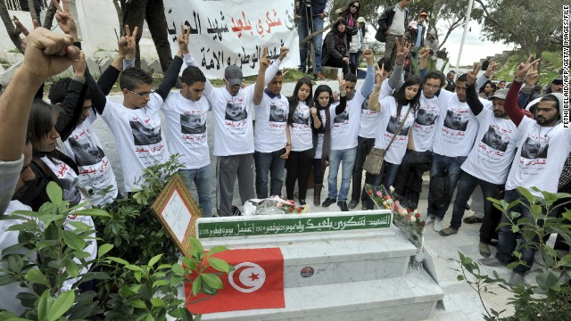People gather at Belaid's tomb in Tunis during a March demonstration.