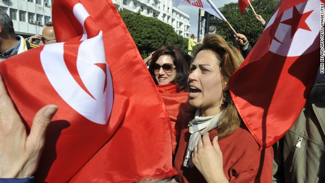 Women shout slogans during a March demonstration in Tunis to commemorate the 40th day of mourning in the opposition leader's death.