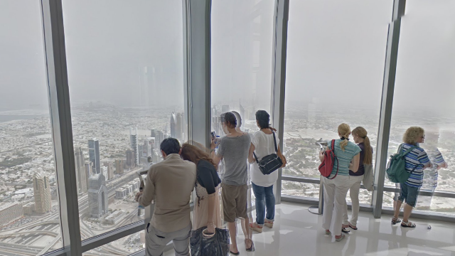 Visitors captured by Google's 360 degree Street View camera look out from the world's highest observation deck.