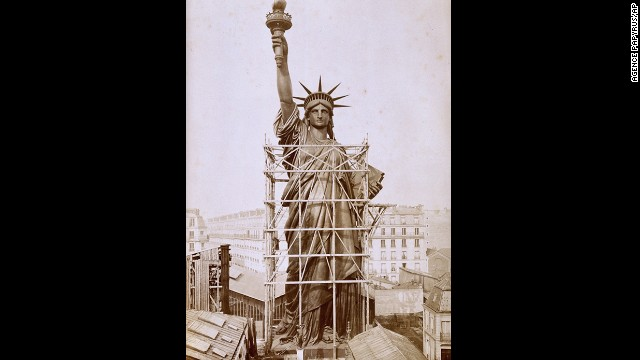 The statue, designed by sculptor Frederic Auguste Bartholdi, towers over Paris rooftops during construction in 1884. It was a gift to the United States from the people of France to commemorate 100 years of Franco-American friendship as well as the centennial of America's independence.
