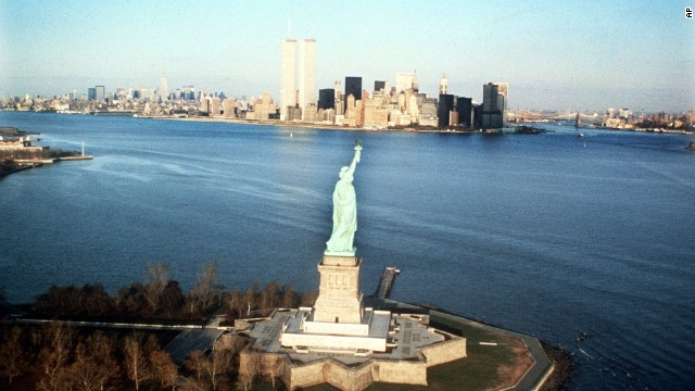 The New York Harbor and World Trade Center are shown behind the Statue of Liberty in 1980.