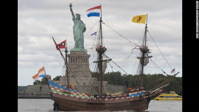 A replica of the Dutch ship Half Moon sails past the Statue of Liberty, commemorating the English navigator Henry Hudson's entry into New York Harbor in 1609.