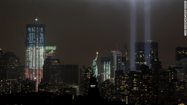 A memorial that echoes the shape of the World Trade Center twin towers is illuminated on the 10th anniversary of the September 11 attacks.