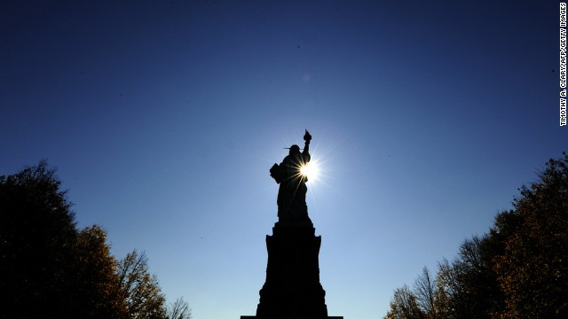 The sun rises in front of the Statue of Liberty before the start of a ceremonies on Liberty Island on October 28, 2011, to commemorate the 125th anniversary of the dedication.