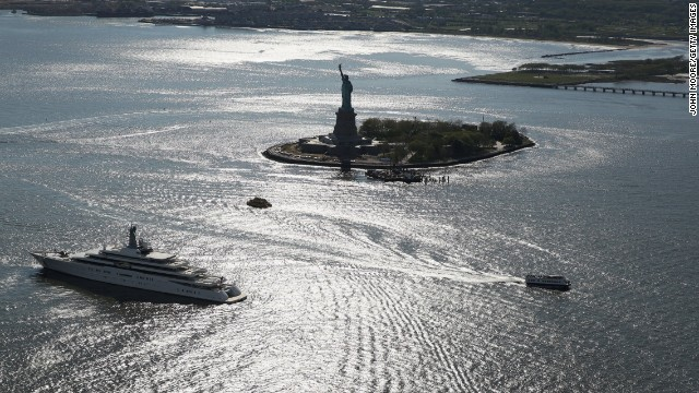 On May 14, boats pass the Statue of Liberty, which had remained closed more than six months after Superstorm Sandy.