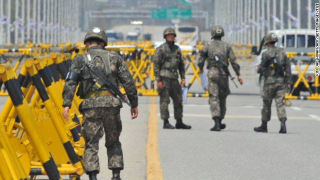 South Korean troops stand at a checkpoint on a road leading to North Korea's Kaesong Industrial Complex in April.