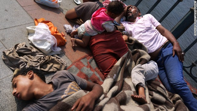 A family sleeps on a bridge near Tahrir Square on July 4.