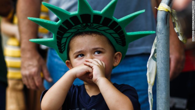 A child attends a ceremony to reopen the Statue of Liberty to the public in New York on July 4.