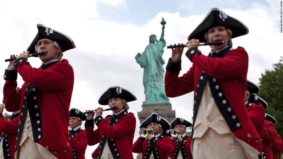 Members of the Old Guard attend the reopening ceremony of the Statue of Liberty in New York on Thursday, July 4. It had been closed to the public since October 29, 2012, because of damage from Superstorm Sandy.