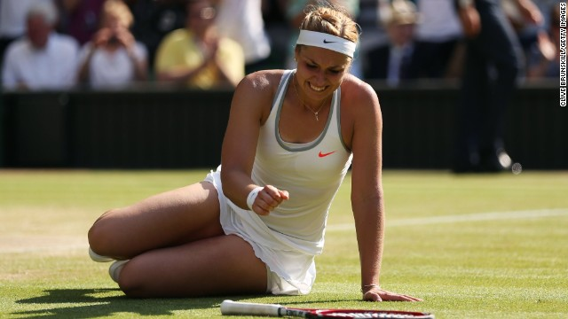 Sabine Lisicki falls to the Centre Court turf after completing an epic three-set semifinal win over Agnieszka Radwanska.