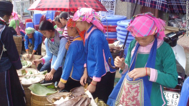 Vietnamese women sell rice at a market stall. The country has now become the second biggest rice exporter in the world.