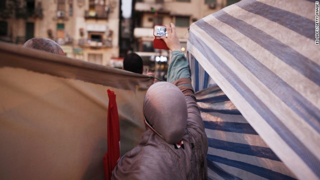 A woman uses a mobile phone to record the July 4 celebrations in Tahrir Square.