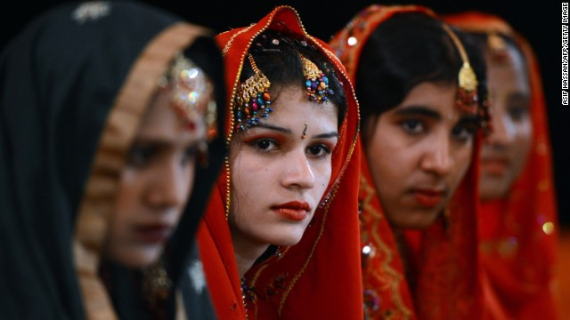 Pakistani brides attend a mass marriage ceremony in Karachi. Some 110 couples participated in the mass wedding ceremony organised by a local charity welfare trust Al Ghousia.