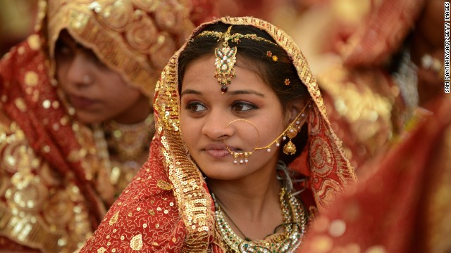 An Indian Muslim bride gestures during a mass wedding ceremony at the ancient Sarkhej Roja in Ahmedabad.