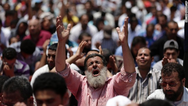 Morsy supporters pray near the University of Cairo in Giza on July 5.