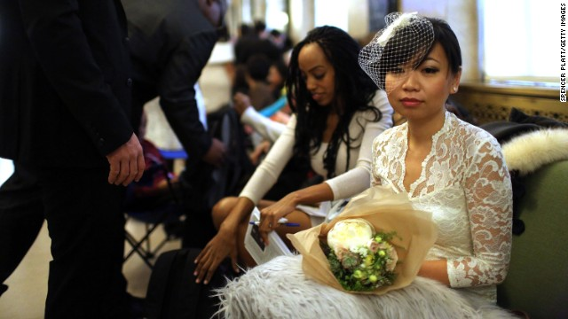 Bride Lini Sasanto waits to fill out marriage papers at a busy City Clerk's office on December 12, 2012 in New York City.
