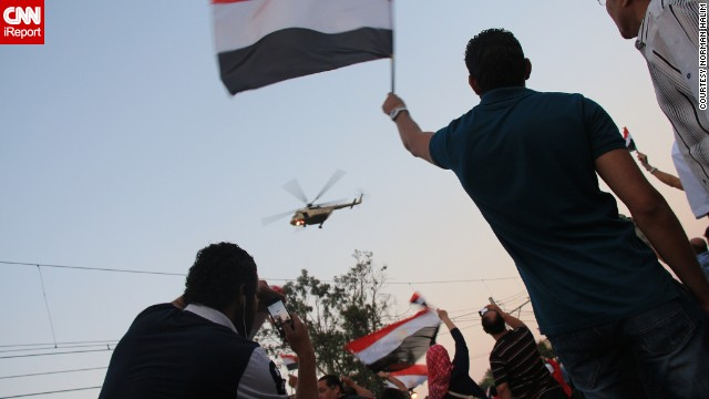 <a href='http://ireport.cnn.com/docs/DOC-999917'>Norman Halim</a> also captured this striking image earlier July 3 of an army helicopter hovering over the crowd.