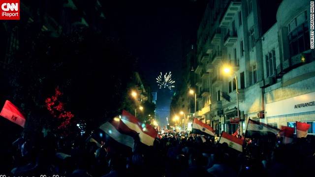 Fireworks and flags filled the sky as anti-Morsy protesters celebrated the toppling of Morsy in this image taken July 3 by <a href='http://ireport.cnn.com/docs/DOC-999917'>Norman Halim</a>, who said he was concerned about what could happen next.
